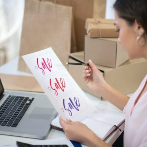 Nice young woman running her online shop